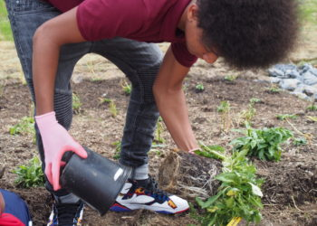 Student at Oxon Hill Middle School participating in a CWP Schools tree planting session.